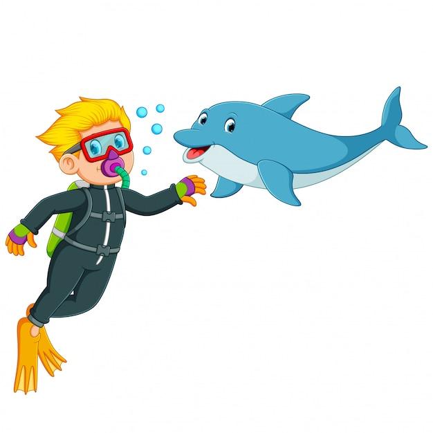 De jongen speelt met de dolfijn onder water Premium Vector