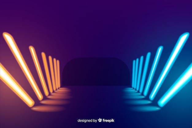 De kleurrijke achtergrond van het neonlichtenstadium Gratis Vector