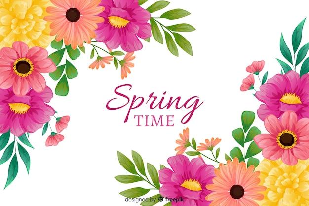 De lenteachtergrond met kleurrijke bloemen Gratis Vector
