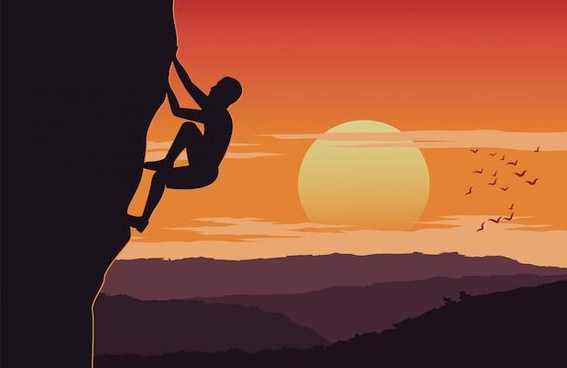 De mens beklimt omhoog klip op zonsondergangtijd Premium Vector