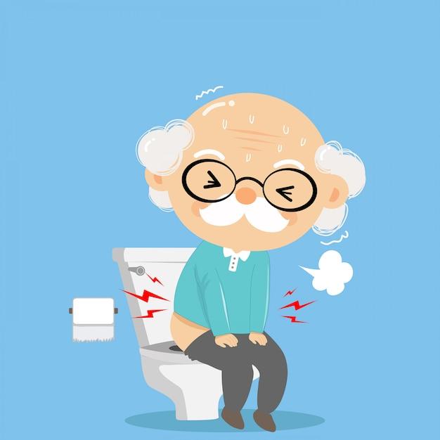 De oude man was pijnlijk in het toilet aan het ontsmetten en ernstig als een slechte gezondheid. Premium Vector