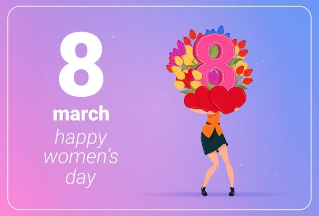 De tulpenbloemen van meisjesholding en rood harten gelukkig vrouwen dag 8 maart-vakantieconcept Premium Vector