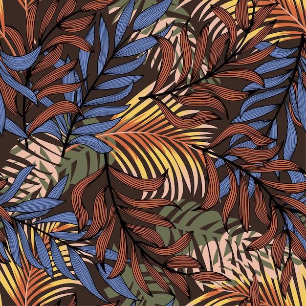 De zomer abstract naadloos patroon met kleurrijke tropische bladeren en planten op een bruine achtergrond Premium Vector