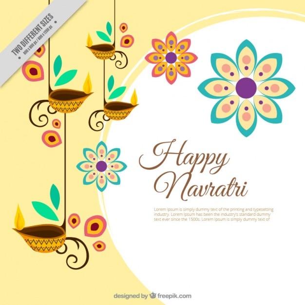 Decoratieve bloemen gelukkig navratri achtergrond van kaarsen Gratis Vector