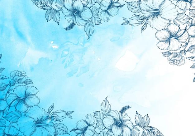 Decoratieve bloemenachtergrond met blauw waterverfontwerp Gratis Vector