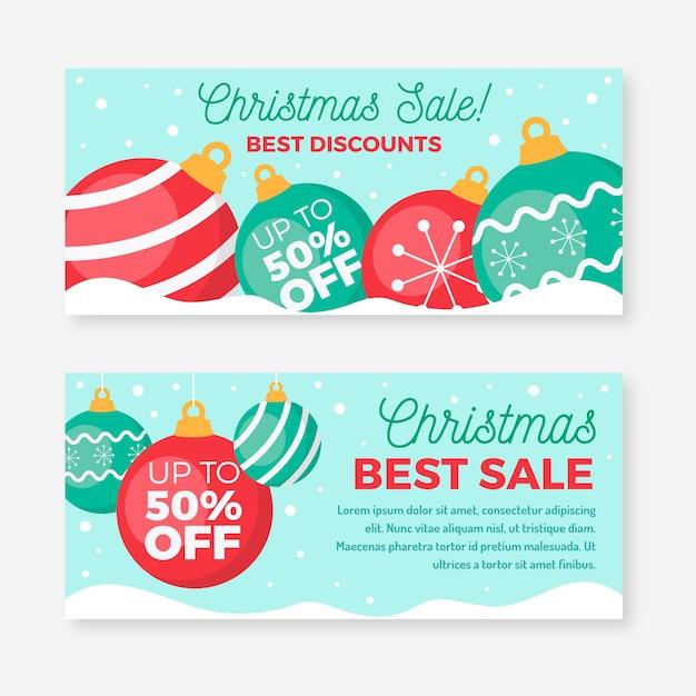 Decoratieve feestelijke ballen kerstmis verkoop banners Gratis Vector