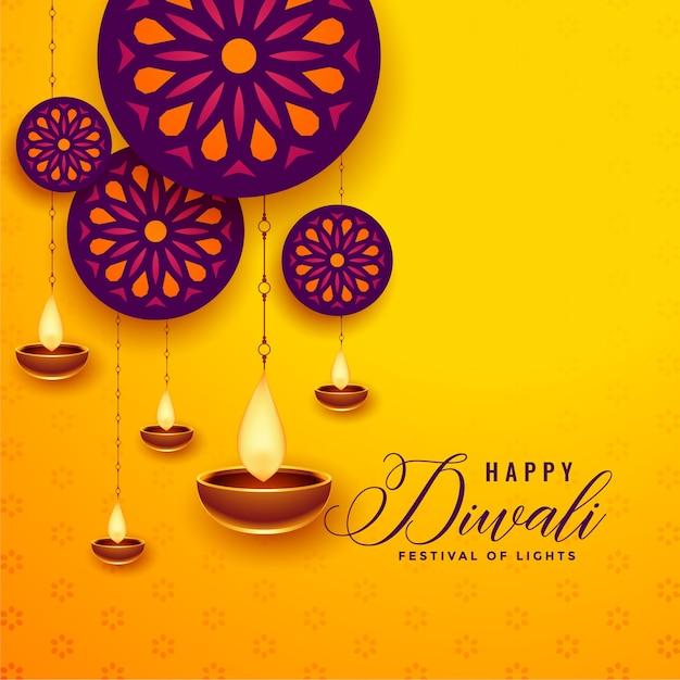 Decoratieve gelukkige diwali-wenskaart met hangende diya Gratis Vector