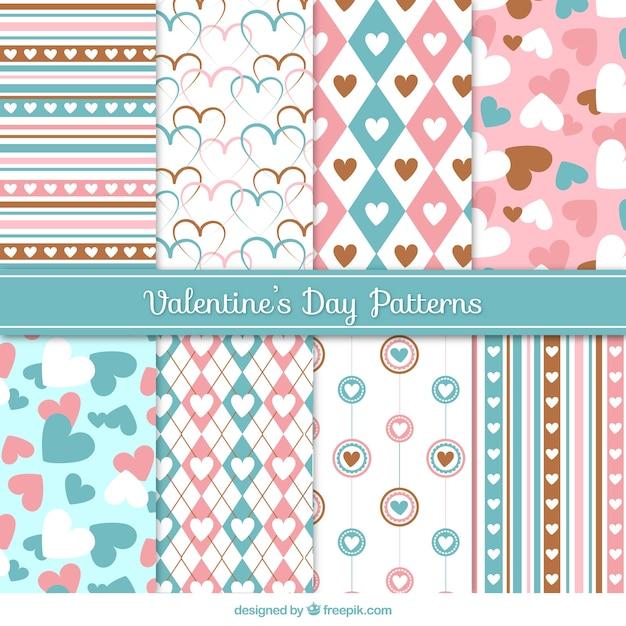 Decoratieve patronen in pastel kleuren voor Valentijnsdag Gratis Vector