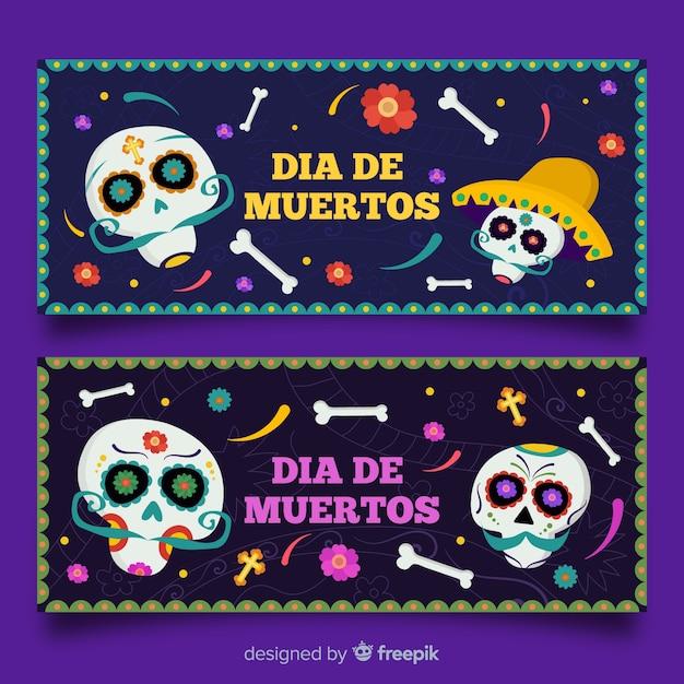 Día de muertos banners met schedels en botten Gratis Vector