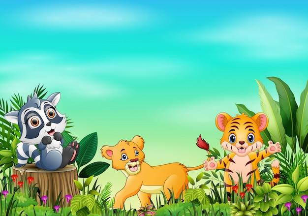 Dierlijke cartoons in prachtige tuinen met een blauwe lucht Premium Vector