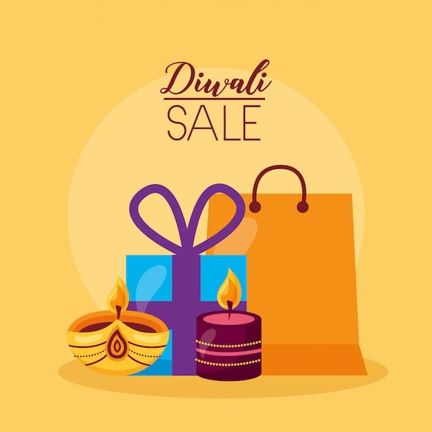 Diwali-verkoopkaart met geschenken en kaarsen Gratis Vector