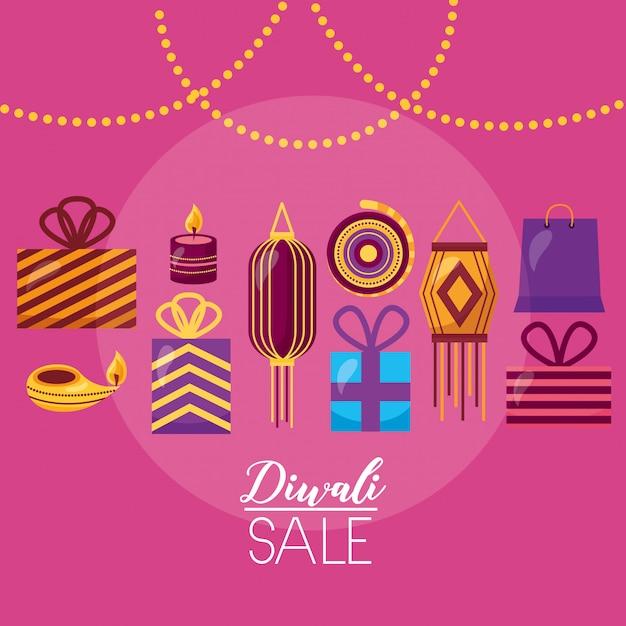Diwali-verkoopkaart met lampen die viering hangen Gratis Vector