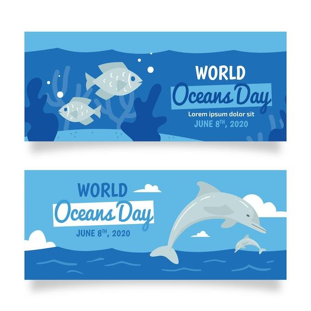 Dolfijn en vis hand getekende oceanen dag banner Gratis Vector