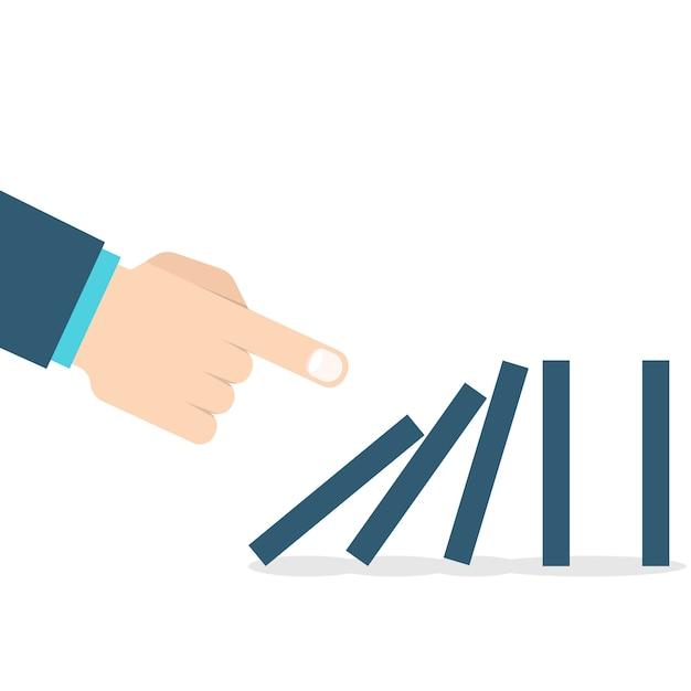 Domino effect. hand duwen de domino. Premium Vector
