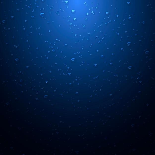 Donkerblauwe achtergrond met waterdruppels Premium Vector