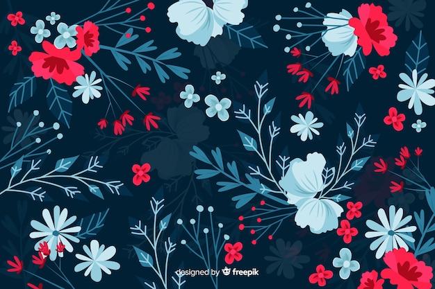 Donkere achtergrond met rode en blauwe bloemen Gratis Vector