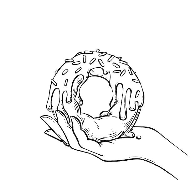 Donut in hand hand getrokken illustratie. Premium Vector