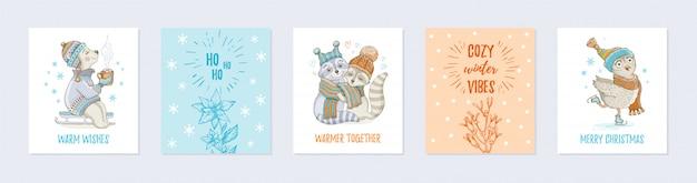 Doodle christmas wenskaart set met schattige dieren Premium Vector