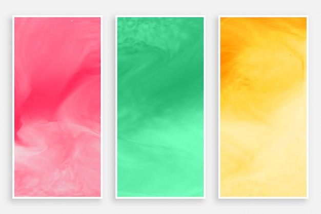 Drie aquarellenbanner in verschillende kleuren Gratis Vector