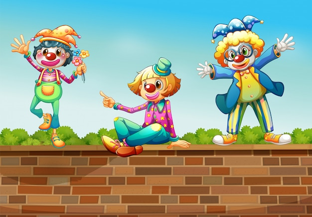 Drie clowns boven de muur Gratis Vector