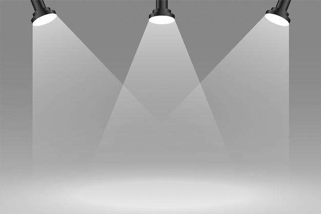Drie focus sportlights achtergrond in grijze kleur Gratis Vector