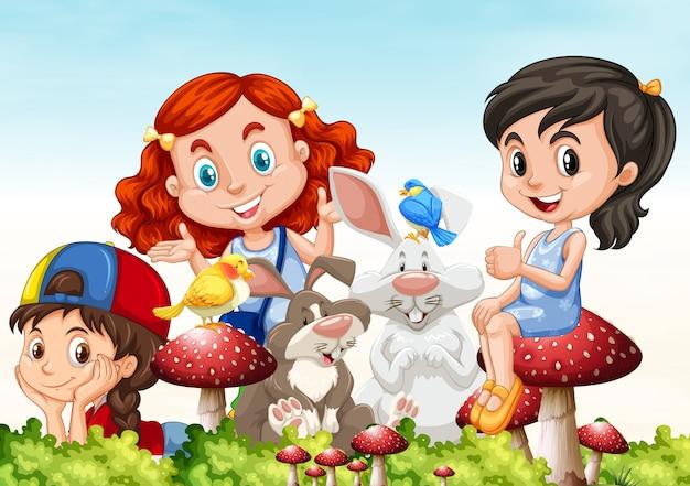 Drie meisjes en konijnen in de tuin Gratis Vector