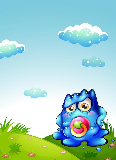 Een baby blauw monster op de heuveltop Gratis Vector
