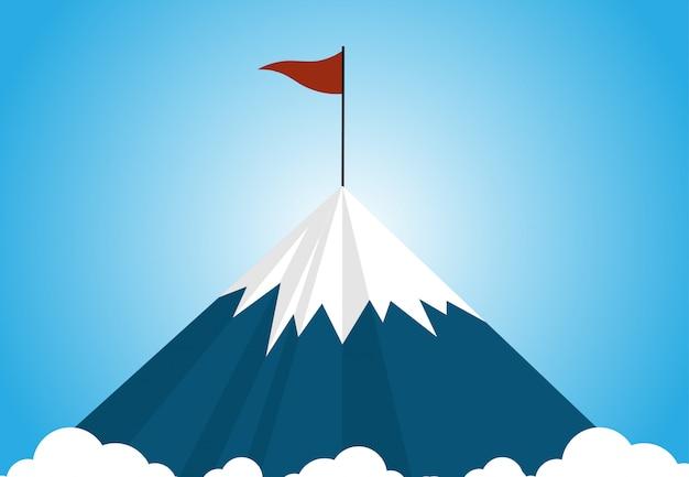 Een berg van de sneeuwdekking boven het wolkenniveau met een rode vlag op de bovenkant van de berg op blauwe hemel Premium Vector