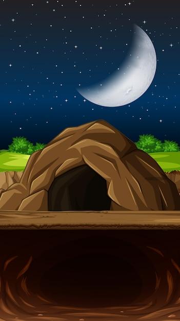Een grot op nigth scène Gratis Vector