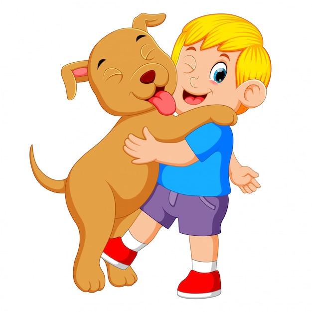 Een kleine jongen speelt en houdt zijn grote hond vast Premium Vector