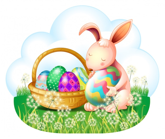 Een konijntje en een mand vol paaseieren Gratis Vector
