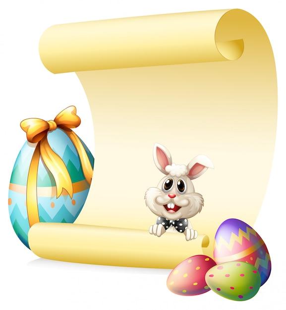 Een lege papieren sjabloon met een konijn en paaseieren Gratis Vector