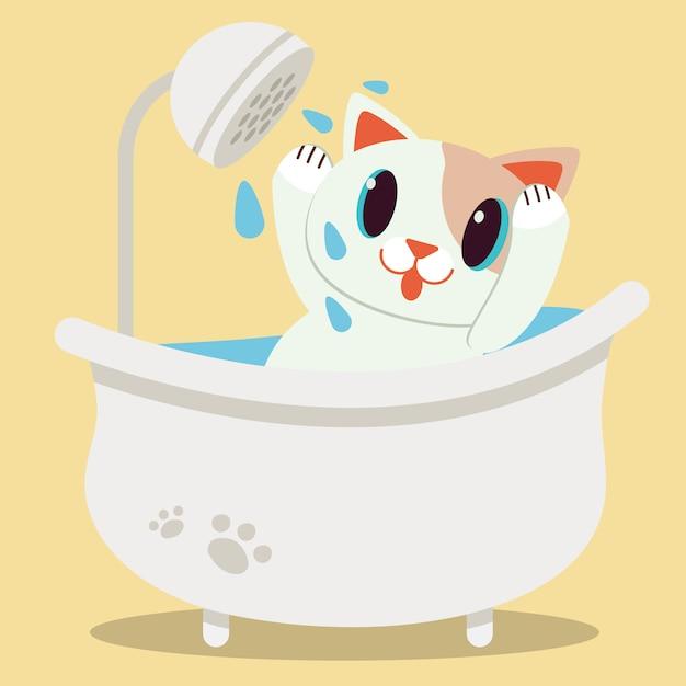 Een leuke kat die van het karakterbeeldverhaal in de badkuip ligt Premium Vector