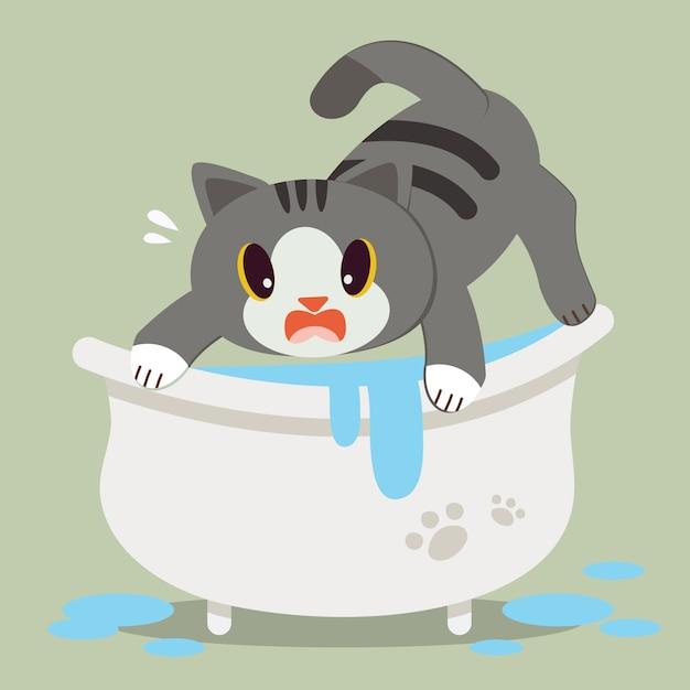 Een leuke kat van het karakterbeeldverhaal bang op badkuip. Premium Vector