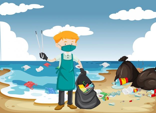 Een man die het strand schoonmaakt Gratis Vector