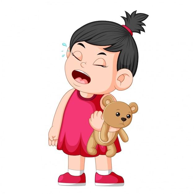 Een meisje dat huilt terwijl ze een bruine teddybeer vasthoudt Premium Vector