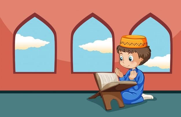 Een moslimjongensstudie in de moskee Premium Vector