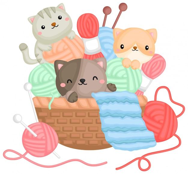 Een vector van katten die met garens in een mand spelen Gratis Vector