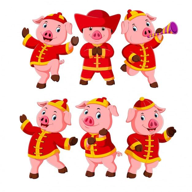 een verzameling van kleine roze varkens gebruikt een Chinees nieuwjaarskostuum Premium Vector