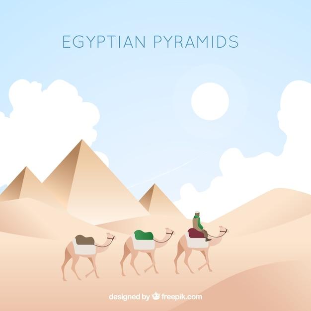 Egyptisch piramideslandschap met caravan van kamelen Gratis Vector
