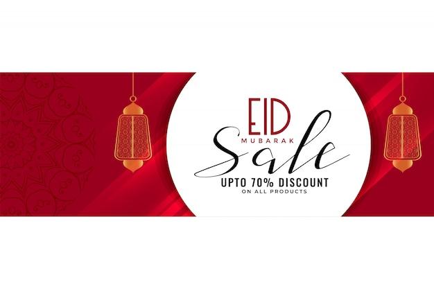 Eid verkoopbanner of kopbal met hangende lantaarns Gratis Vector