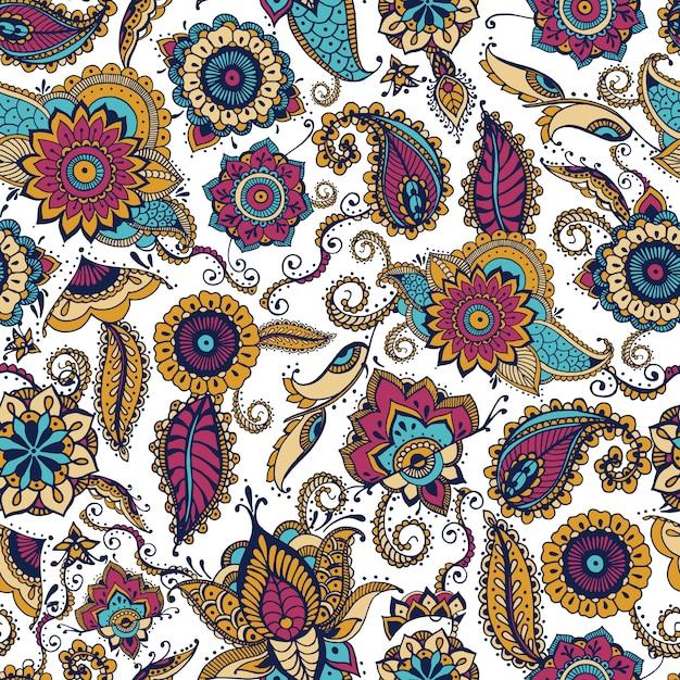 Elegant paisley naadloos patroon met kleurrijke indiase buta motief en bloemen mehndi elementen Premium Vector