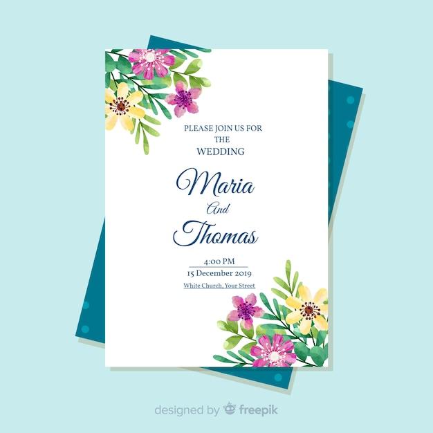 Elegante bloemenhuwelijksuitnodigingskaart Gratis Vector