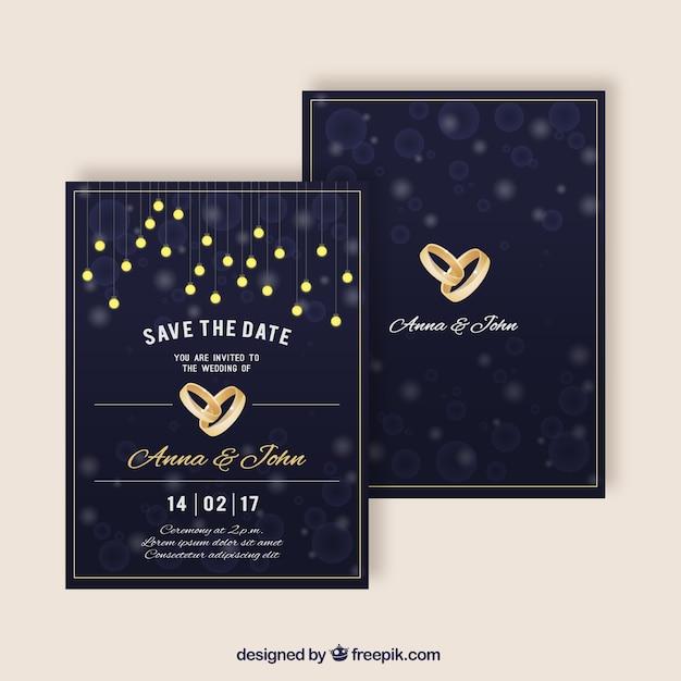 Elegante huwelijksuitnodigingen met gouden ringen Gratis Vector