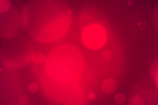 Elegante onscherpe rode bokeh steekt achtergrond aan Gratis Vector