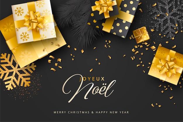 Elegante zwarte en gouden realistische kerstachtergrond Gratis Vector