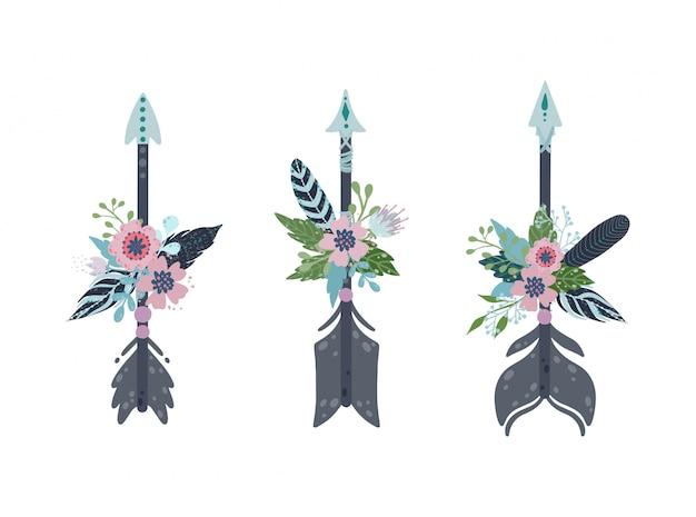 Etnische boho pijlen instellen. pijlen, veren en bloemendecoratie in vintage boheemse stijl. Premium Vector