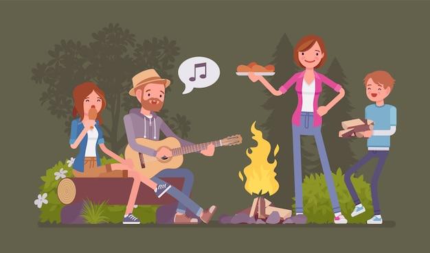 Familie bij kampvuur. ouders en kinderen kamperen 's nachts in de buurt van vuur, blijven buiten, genieten van het weekend samen zingen en eten, tijd voor recreatie-avontuur. stijl cartoon illustratie Premium Vector