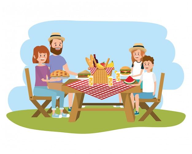 Familie op picknick Premium Vector