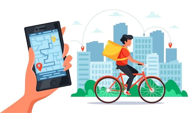 Fiets levering dienstverleningsconcept. koerier op de fiets met bezorgdoos, hand met smartphone met online tracking. in vlakke stijl. Premium Vector